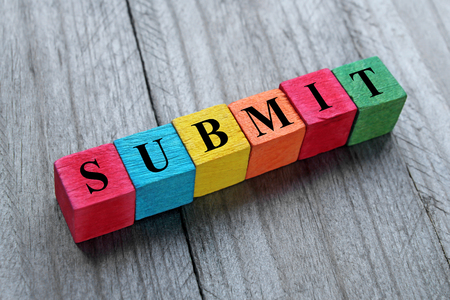 submit word on colorful wooden cubes Stock Photo