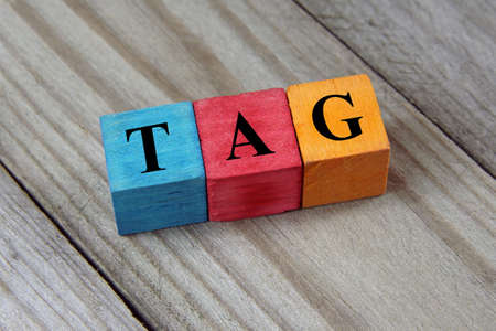 annotation: tag word on colorful wooden cubes Stock Photo