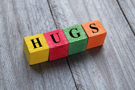 togheter: hugs word on colorful wooden cubes