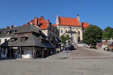 localization: Kazimierz Dolny - JULY 7: Parish Church and market square in Kazimierz Dolny; on July 7, 2015 in Kazimierz Dolny, Poland. Its a small town with the most beautiful localization and historic architecture in Poland. Editorial