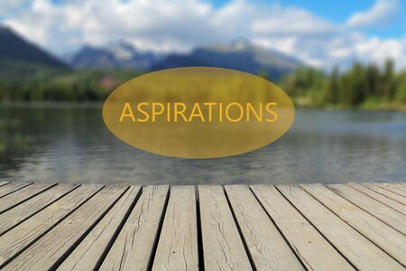 aspirations: text aspirations, mountain lake in the background Stock Photo