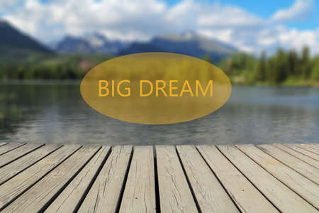 dream lake: big dream text, mountain lake in the background Stock Photo