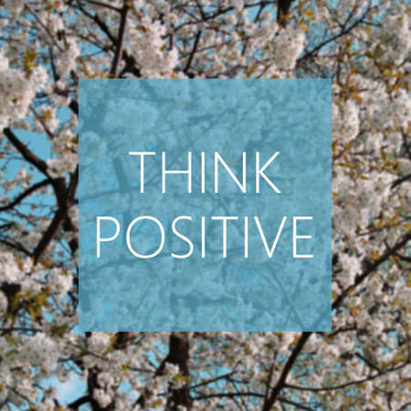 think positive: Think Positive concept, spring blooming tree in the background Stock Photo