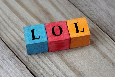 laughing out loud: LOL Laughing Out Loud text on colorful wooden cubes