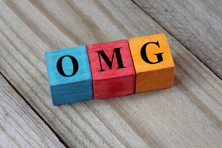oh: OMG Oh My God text on colorful wooden cubes