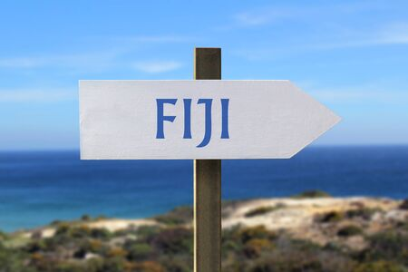 Fiji sign with seashore in the background