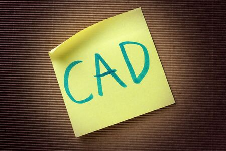 canadian dollar: CAD Canadian Dollar acronym on yellow sticky note Stock Photo