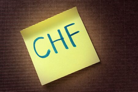 swiss franc note: CHF Swiss Franc acronym on yellow sticky note