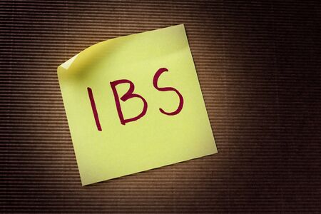 bowel: IBS Irritable Bowel Syndrome acronym on yellow sticky note