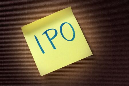 public offering: IPO Initial Public Offering acronym on yellow sticky note