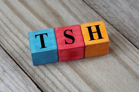 TSH Thyroid-stimulating hormone symbol on colorful wooden cubes