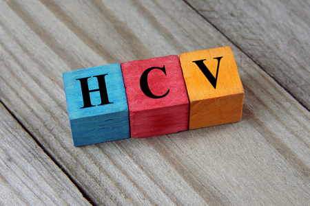 polymerase: HCV Hepatitis C virus acronym on colorful wooden cubes Stock Photo