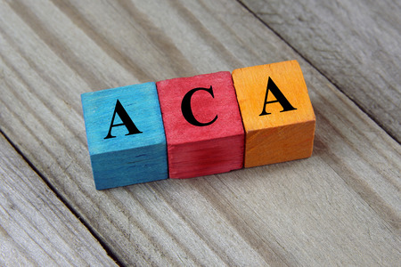 ACA Affordable Care Act acronym on colorful wooden cubes Stock Photo