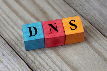dns: DNS Domain Name System acronym on colorful wooden cubes
