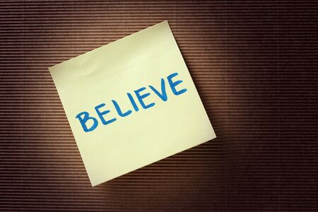 believe: Believe text on yellow sticky note