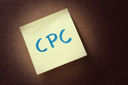 cpc: CPC (Cost Per Click) acronym on yellow sticky note