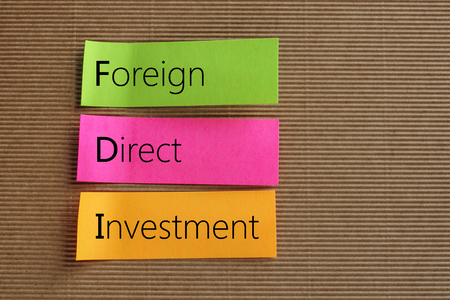Foreign Direct Investment (FDI) text on colorful sticky notes