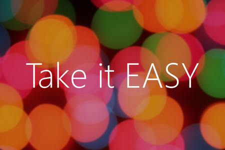 take it easy: Take it easy text on colorful background bokeh Stock Photo