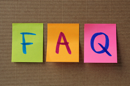 FAQ (Frequently Asked Questions) acronym on colorful sticky notes Stockfoto