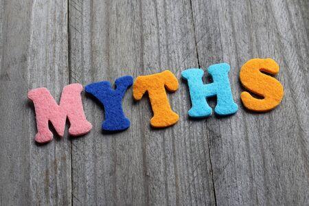 myths: myths text on wooden background