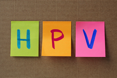 oral cancer: HPV acronym on colorful sticky notes