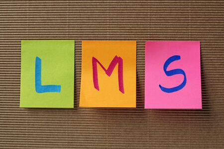 competences: LMS acronym on colorful sticky notes