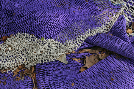 deatil: violet fishing nets drying in the sun