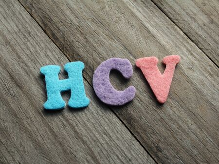 polymerase: HCV (Hepatitis C virus) acronym on wooden background Stock Photo
