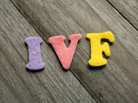 ivf: IVF (In Vitro Fertilization) acronym on wooden background