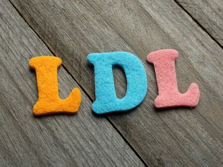 good cholesterol: LDL (low-density lipoprotein) acronym on wooden background Stock Photo