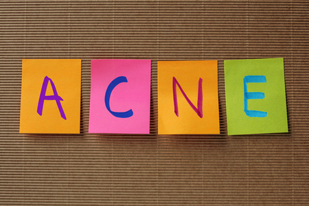 overproduction: acne word acronym on color
