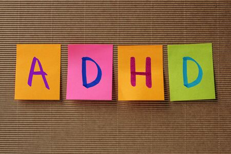 hyperactivity: ADHD (Attention Deficit Hyperactivity Disorder) acronym on colorful sticky notes