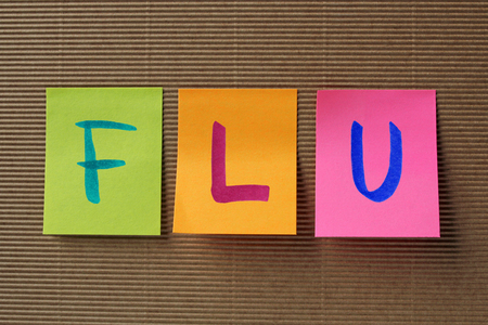 swine flu vaccination: flu word on colorful sticky notes