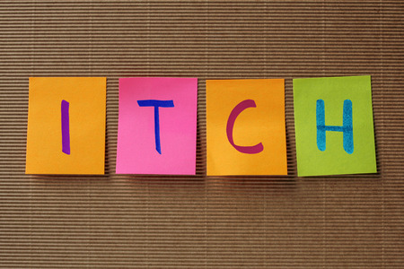 itch: itch text on colorful sticky notes Stock Photo