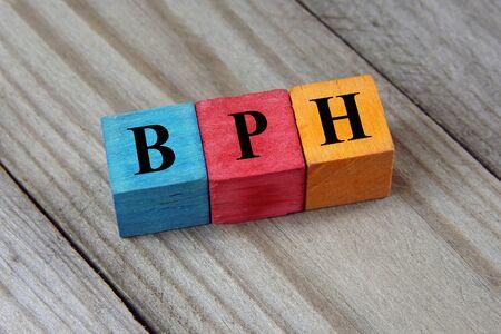 prostatic: BPH (Benign Prostatic Hyperplasia) acronym on wooden background