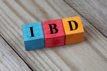bowel: IBD (Inflammatory Bowel Disease) acronym on wooden background