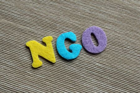 ngo: NGO (Non-Governmental Organization) acronym made with colorful felt letters Stock Photo