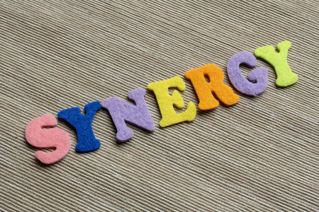 synergy: synergy word made with colorul felt letters