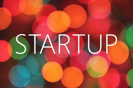 undertaking: startup text on bokeh background Stock Photo