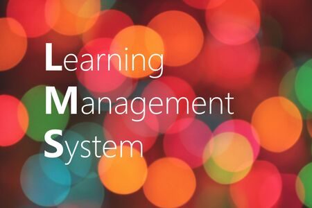 competences: LMS (Learning Management System) acronym on colorful background bokeh Stock Photo