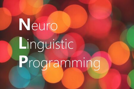 linguistic: NLP (Neuro Linguistic Programming) acronym on colorful background bokeh Stock Photo