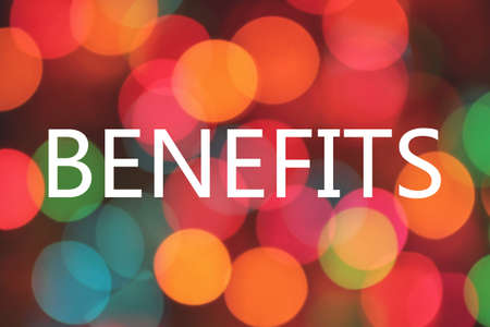 compensate: benefits word on colorful blurred bokeh background