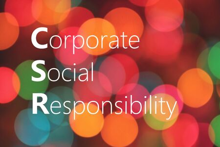 Corporate Social Responsibility (CSR) text on colorful background bokeh