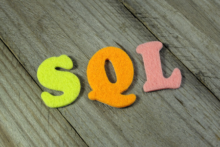acronym: SQL (Structured Query Language) acronym on wooden background Stock Photo