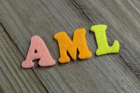 neoplasm: AML (Acute myeloid Leukemia) acronym on wooden background Stock Photo