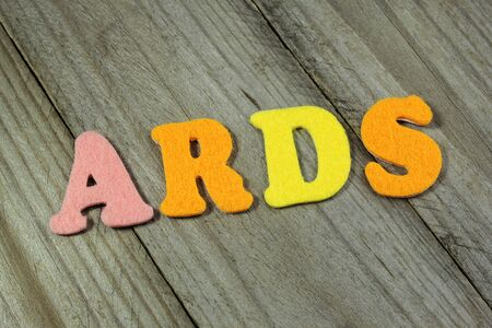 acute: ARDS (Acute Respiratory Distress Syndrome) acronym on wooden background Stock Photo