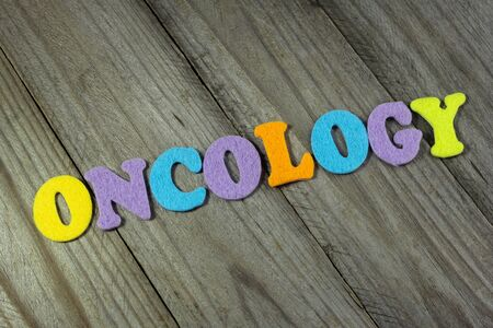 oncology: oncology word on wooden background