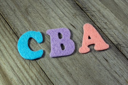 estimating: CBA (Cost-benefit analysis) acronym on wooden background