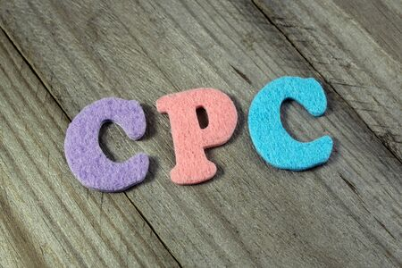 cpc: CPC (Cost Per Click) acronym on wooden background