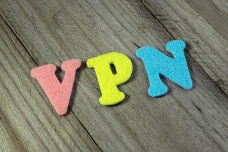 url virtual: VPN (Virtual Private Network) acronym on wooden background Stock Photo